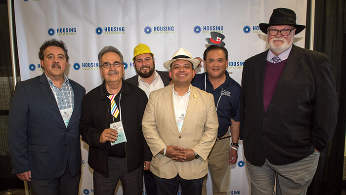 A group of Housing California members and board members smile at the camera during the Annual Conference.